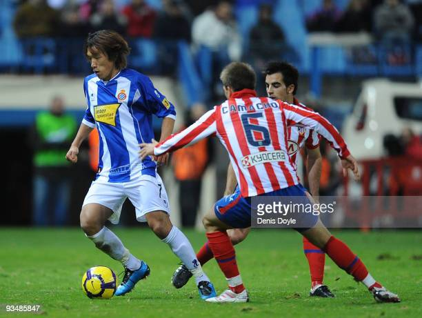 Shunsuke Nakamura of Espanyol is tackled by Ignacio Camacho of Atletico Madrid during the La Liga match between Espanyol and Atletico Madrid at the...