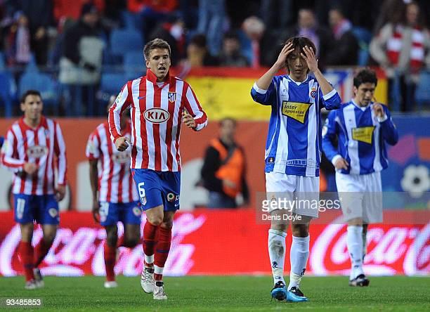 Shunsuke Nakamura of Espanyol reacts beside Ignacio Camacho after Atletico Madrid scored their fourth goal during the La Liga match between Espanyol...