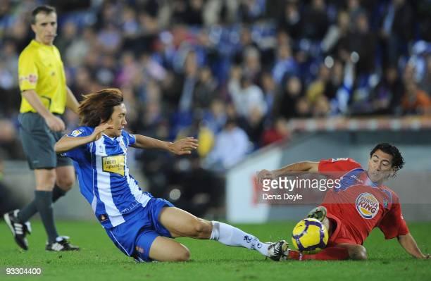 Shunsuke Nakamura of Espanyol tackles Pedro Rios of Getafe during the La Liga match between Espanyol and Getafe at CornellaEl Prat stadium on...
