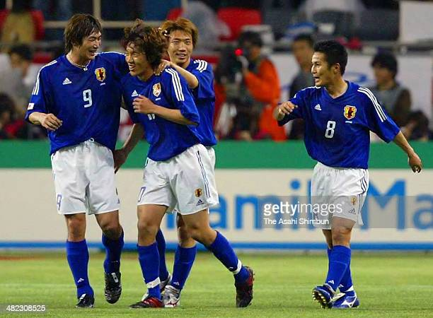 Shunsuke Nakamura of Japan celebrates scoring his team's first goal with his teammates Akinori Nishizawa Yasuhiro Hato and Hiroaki Morishima during...