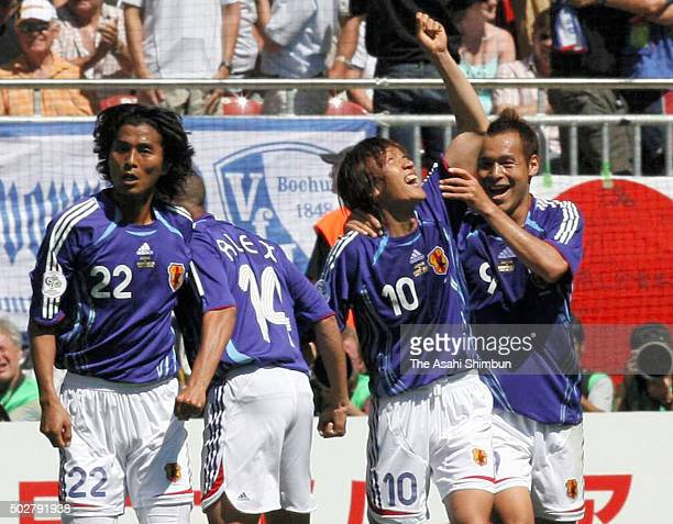 Shunsuke Nakamura of Japan celebrates scoring his team's first goal with his team mates during the FIFA World Cup Germany 2006 Group F match between...