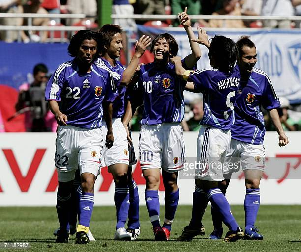 Shunsuke Nakamura of Japan celebrates with teammates after scoring the opening goal during the FIFA World Cup Germany 2006 Group F match between...