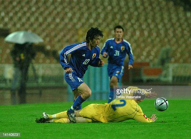 Shunsuke Nakamura of Japan is tackled by Andriy Nesmachnyi of Ukraine during the international friendly match between Ukraine and Japan at Olympic...