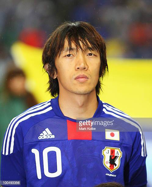 Shunsuke Nakamura of Japan lines up for the national anthems before the international friendly match between Japan and South Korea at Saitama Stadium...