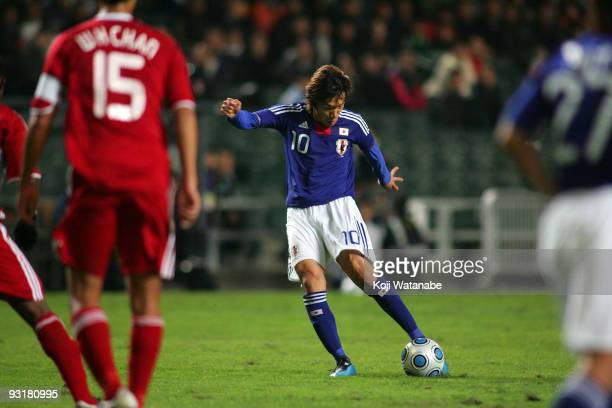 Shunsuke Nakamura of Japan scores the third goal during AFC Asia Cup 2011 Qatar qualifier match between Hong Kong and Japan at Hong Kong Stadium on...