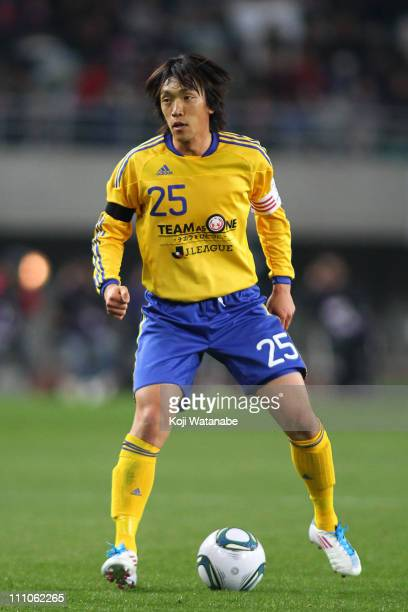 Shunsuke Nakamura of JLeague XI 'Team As One' in action during the charity match for those suffer the earthquake and tsunami at Nagai Stadium on...