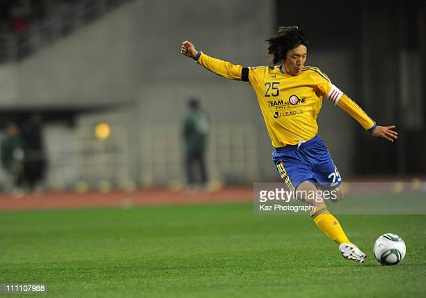 Shunsuke Nakamura of JLeague XI 'Team As One' takes a shot at goal during the charity match for the victims and those that suffered through the...