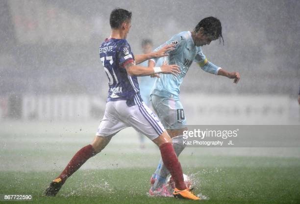 Shunsuke Nakamura of Jubilo Iwata and Ippei Shinozuka of Yokohama FMarinos compete for the ball during the JLeague J1 match between Jubilo Iwata and...
