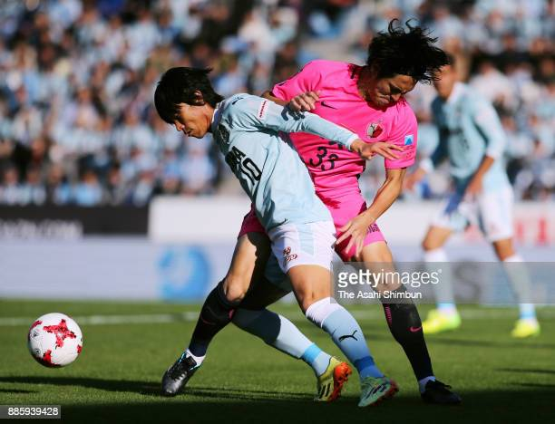 Shunsuke Nakamura of Jubilo Iwata and Mu Kanazaki of Kashima Antlers compete for the ball during the JLeague J1 match between Jubilo Iwata and...