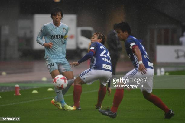 Shunsuke Nakamura of Jubilo Iwata and Ryosuke Yamanaka of Yokohama FMarinos compete for the ball during the JLeague J1 match between Jubilo Iwata and...