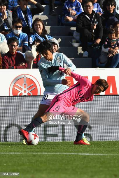 Shunsuke Nakamura of Jubilo Iwata and Shoma Doi of Kashima Antlers compete for the ball during the JLeague J1 match between Jubilo Iwata and Kashima...