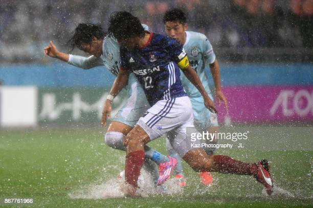Shunsuke Nakamura of Jubilo Iwata and Yuji Nakazawa of Yokohama FMarinos compete for the ball during the JLeague J1 match between Jubilo Iwata and...