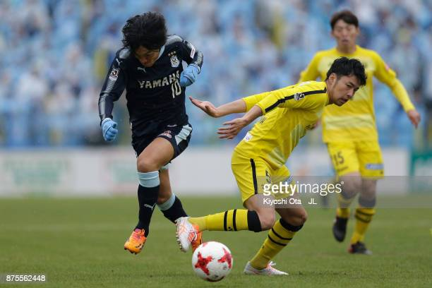 Shunsuke Nakamura of Jubilo Iwata and Yuta Nakayama of Kashiwa Reysol compete for the ball during the JLeague J1 match between Kashiwa Reysol and...
