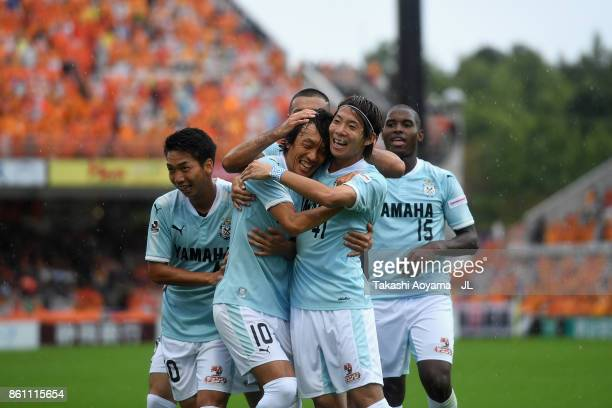 Shunsuke Nakamura of Jubilo Iwata celebrates scoring his side's second goal with his team mates during the JLeague J1 match between Shimizu SPulse...