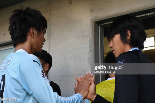 Shunsuke Nakamura of Jubilo Iwata consoles his team mate Koki Ogawa after their team's 22 draw in the JLeague J1 match between Jubilo Iwata and...