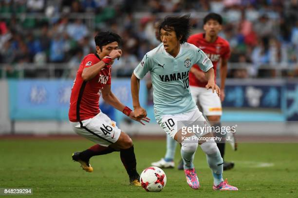 Shunsuke Nakamura of Jubilo Iwata controls the ball under pressure of Ryota Moriwaki of Urawa Red Diamonds during the JLeague J1 match between Jubilo...