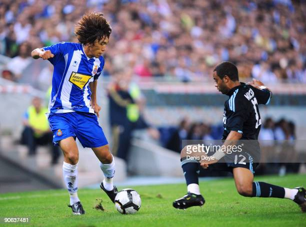 Shunsuke Nakamura of RCD Espanyol is tackled by Marcelo of Real Madrid during the La Liga match between Espanyol and Real Madrid at the Nuevo Estadio...