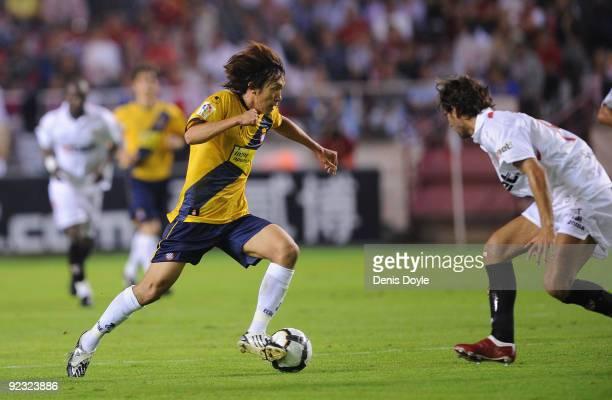 Shunsuke Nakamura of RCD Espanyol takes on a Sevilla player during the La Liga match between Espanyol and Sevilla at Estadio Ramon Sanchez Pizjuan on...