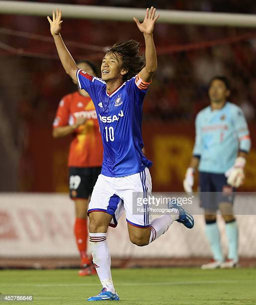 Shunsuke Nakamura of Yokohama FMarinos celebrates scoring his team's first goal during the J League match between Nagoya Grampus and Yokohama...