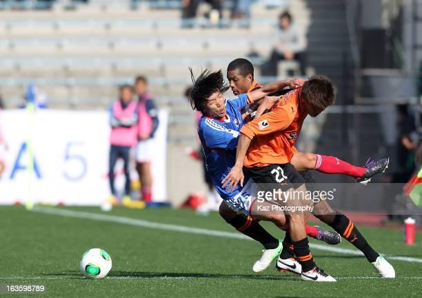 Shunsuke Nakamura of Yokohama FMarinos is tackled by Kenta Uchida of Shimizu SPulse during the JLeague match between Shimizu SPulse and Yokohama...