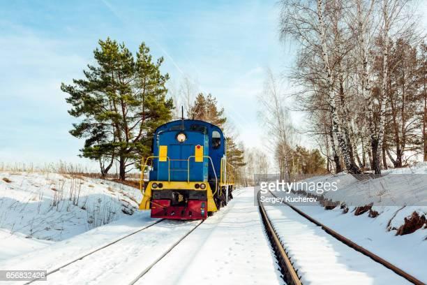 Shunting locomotive in winter landscape