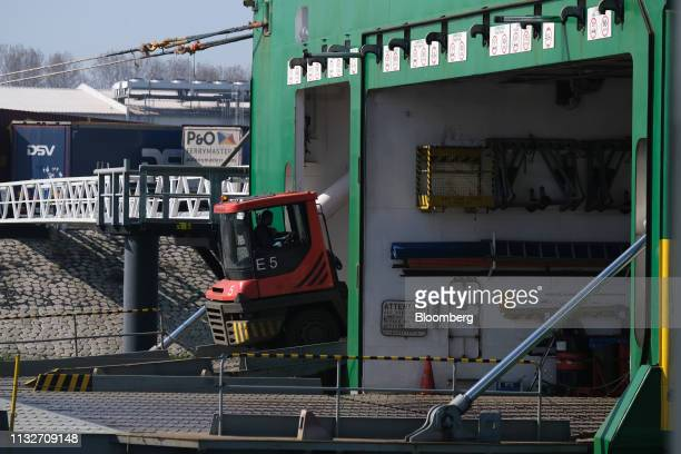 A shunting vehicle drives a cargo truck trailer aboard rollon rolloff vessel Misida during a 'Get Ready For Brexit' press tour of the Port of...