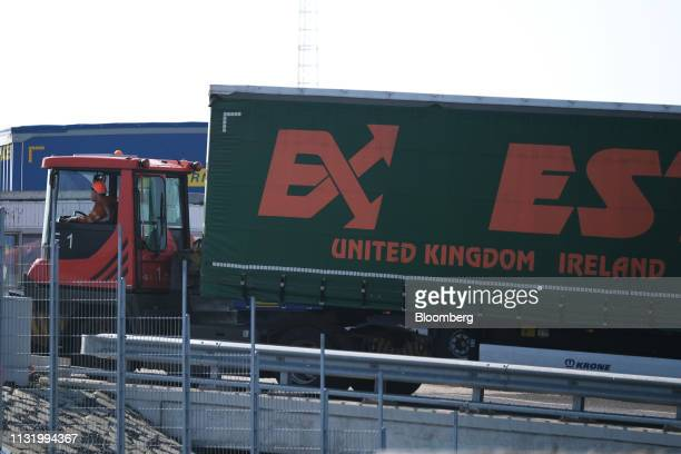 A shunting vehicle unloads a cargo truck trailer with the words 'United Kingdom' and 'Ireland' on its curtain siding during a 'Get Ready For Brexit'...