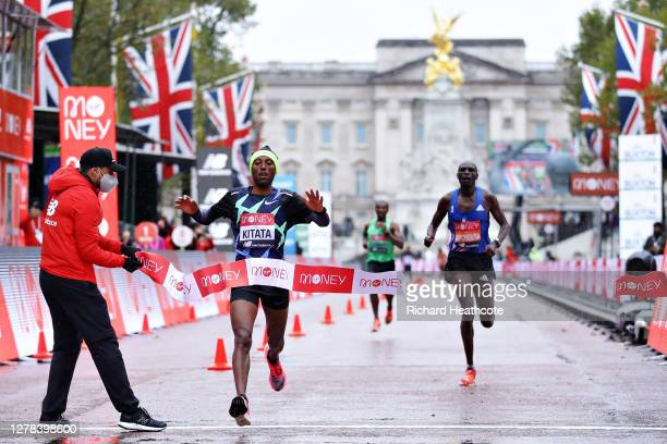 Shura Kitata of Ethiopia crosses the line in first place ahead of Vincent Kipchumba of Kenya in the Elite Men's race during the 2020 Virgin Money...