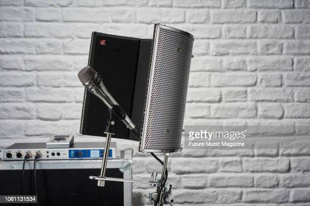 A Shure KSM8 cardioid dynamic microphone and SE Electronics Reflexion Filter Pro taken on March 12 2018