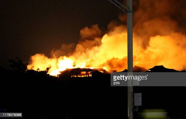 Shuri Castle is engulfed in flames in Naha Okinawa prefecture southern Japan on early October 31 2019 A fire ripped through the ancient Japanese...