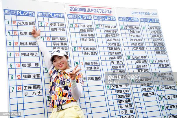 Shuri Sakuma of Japan points her name on the leaders board as she celebrates passing the professional test following the final round of the JLPGA Pro...