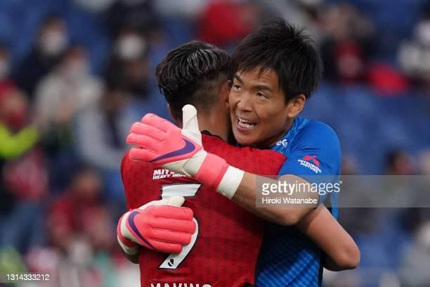 Shusaku Nishikawa and Tomoaki Makino of Urawa Red Diamonds celebrate the win after the J.League Meiji Yasuda J1 match between Urawa Red Diamonds and...