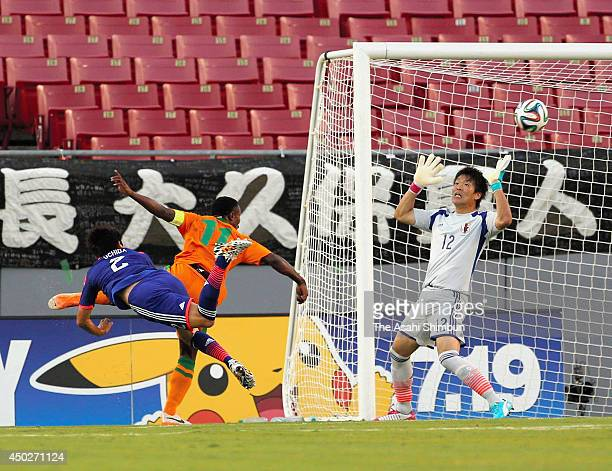 Shusaku Nishikawa of Japan fails to stop Zambia's first goal during the international friendly match between Japan and Zambia at Raymond James...