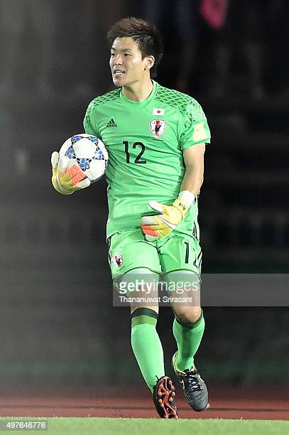 Shusaku Nishikawa of Japan holds the ball during the 2018 FIFA World Cup Qualifier match between Cambodia and Japan on November 17 2015 in Phnom Penh...