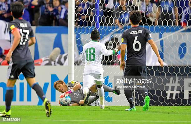 Shusaku Nishikawa of Japan makes a save during the 2018 FIFA World Cup Qualifier match between Japan and Saudi Arabia at Saitama Stadium on November...