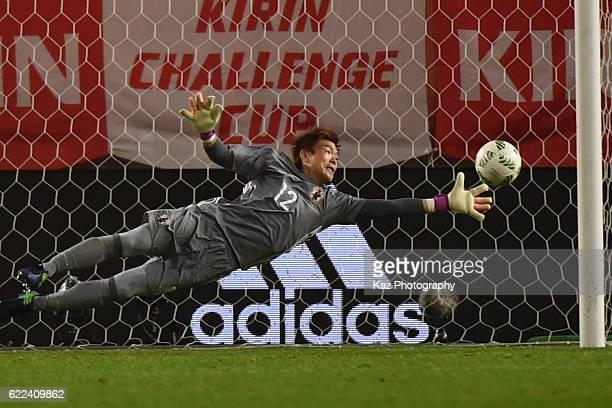 Shusaku Nishikawa of Japan saves the ball during the international friendly match between Japan and Oman at Kashima Soccer Stadium on November 11...