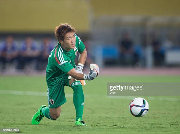 Shusaku Nishikawa of Japan throws the ball in group match between Japan and South Korea during EAFF East Asian Cup 2015 at Wuhan Sports Center...