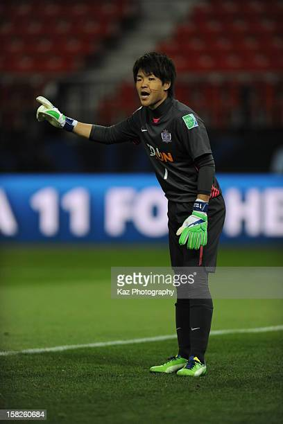 Shusaku Nishikawa of Sanfrecce Hiroshima gives advice to his teammates during the FIFA Club World Cup fifthplace match between Ulsan Hyundai and...