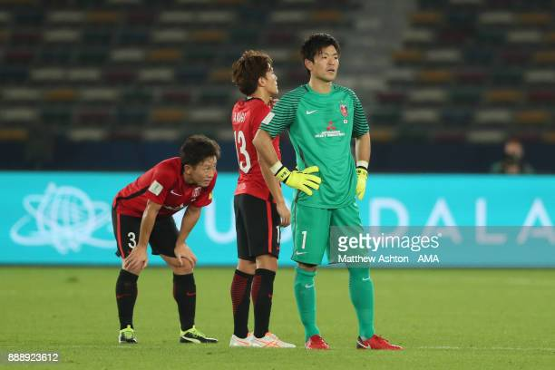 Shusaku Nishikawa of Urawa Red Diamonds and his teammates look dejected at the end of the FIFA Club World Cup UAE 2017 match between Al Jazira and...