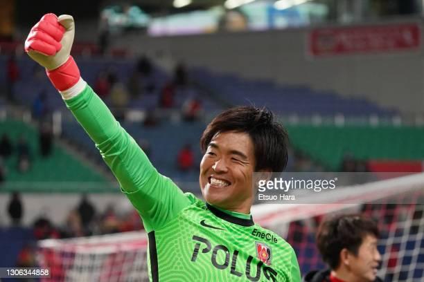 Shusaku Nishikawa of Urawa Red Diamonds applauds fans after the J.League Meiji Yasuda J1 match between Urawa Red Diamonds and Yokohama FC at the...