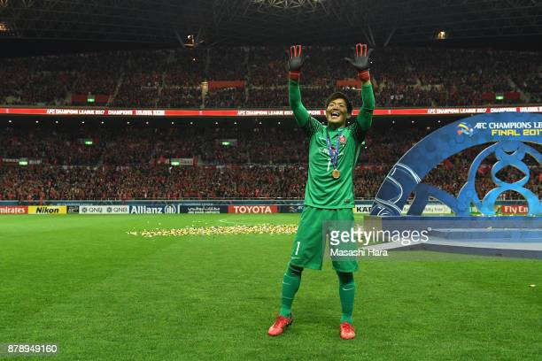 Shusaku Nishikawa of Urawa Red Diamonds applauds supporters after the AFC Champions League Final second leg match between Urawa Red Diamonds and...
