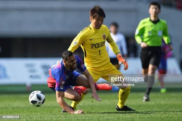 Shusaku Nishikawa of Urawa Red Diamonds compete for the ball against Diego Olivera of FC Tokyo during the JLeague J1 match between FC Tokyo and Urawa...