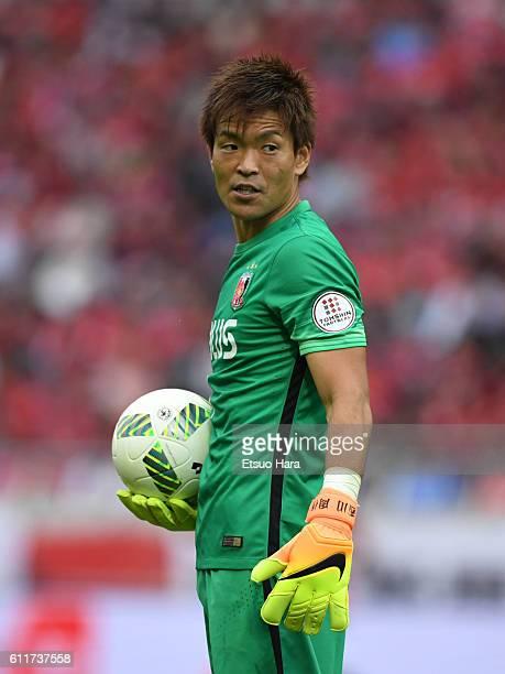 Shusaku Nishikawa of Urawa Red Diamonds in action during the JLeague match between Urawa Red Diamonds and Gamba Osaka at Saitama Stadium on October 1...