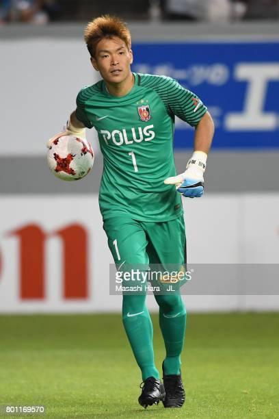 Shusaku Nishikawa of Urawa Red Diamonds in action during the JLeague J1 match between Sagan Tosu and Urawa Red Diamonds at Best Amenity Stadium on...