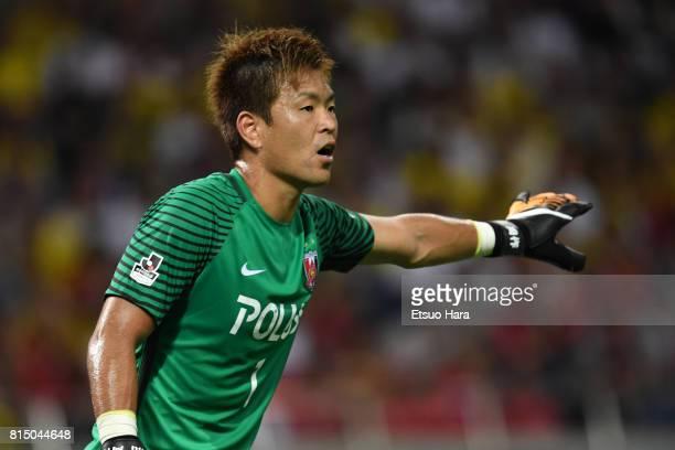 Shusaku Nishikawa of Urawa Red Diamonds in action during the preseason friendly match between Urawa Red Diamonds and Borussia Dortmund at Saitama...