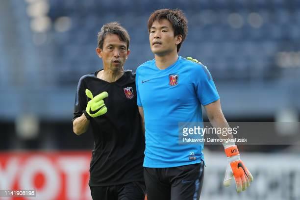 Shusaku Nishikawa of Urawa Red Diamonds listens to his goalkeeper coach during the AFC Champions League Group G match between Buriram United and...