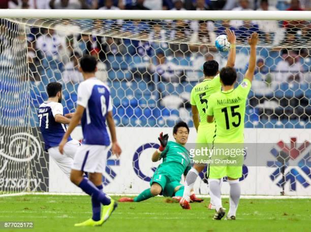 Shusaku Nishikawa of Urawa Red Diamonds makes a save during the AFC Champions League Final 2017 first leg between AlHilal and Urawa Red Diamonds at...