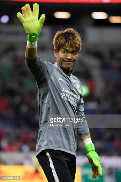 Shusaku Nishikawa of Urawa Red Diamonds waves prior to the JLeague J1 match between Urawa Red Diamonds and Ventforet Kofu at Saitama Stadium on March...