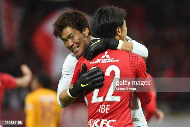 Shusaku Nishikawa of Urawa Reds celebrates the win with Yuki Abe after the 98th Emperor's Cup Final between Urawa Red Diamonds and Vegalta Sendai at...