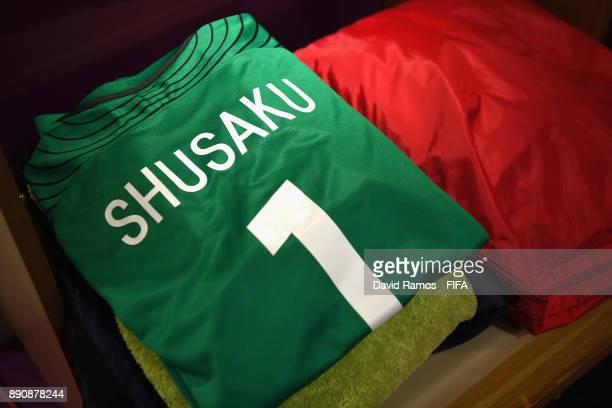 Shusaku Nishikawa of Urawa Reds shirt is seen in the dressing room prior to the FIFA Club World Cup UAE 2017 fifth place playoff match between Wydad...